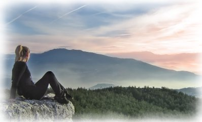 Woman Sitting on Top of Mountain
